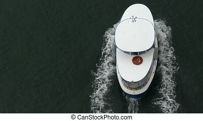 Small ship moving water surface top view - Aqua bus floating...