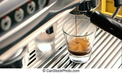 Coffee machine, close up. Fresh espresso with foam.