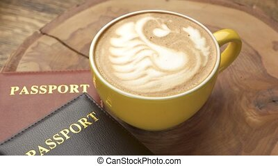 Coffee cup and passports. Documents on wooden board. Fun...