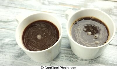 Two espresso cups close up. White mugs with dark coffee....