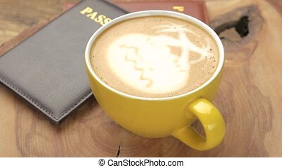 Passports and coffee cup. Latte art palm trees. Make...