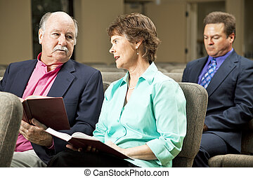 Mature Couple in Church - Mature couple sitting in church...