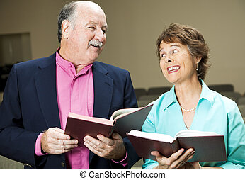 Singing From Hymnal - Husband and wife in church, singing...