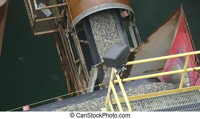 Belt conveyer unloading rock formation - Industrial belt...