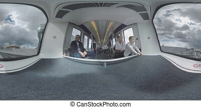 360 VR Driveless train with passengers traveling in...