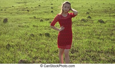 Girl wind nature. girl is standing in the field of grass green. Woman lifestyle freedom