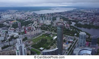 An aerial view of downtown Moscow looking over River Moscow. Top view of mid town in Moscow. Russian city skyline aerial view in the afternoon with the lights over blue hour