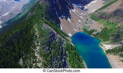 Beautiful aerial view Banff - Mountains range pines blue...