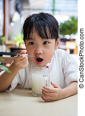 Asian Chinese little girl drinking beverage