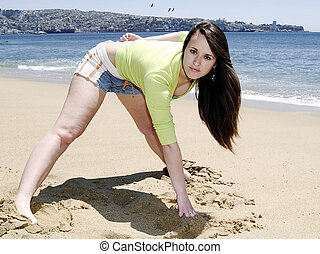 Girl doing sport at beach