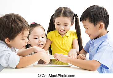 group of school kids studying with tablet