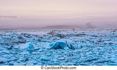 sun light reflecting on iceberg glacier lagoon, jokulsarlon...