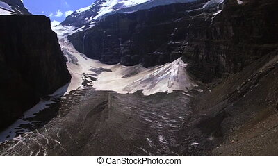 Aerial tilt snow mountains - Plain of Six Glaciers Banff...
