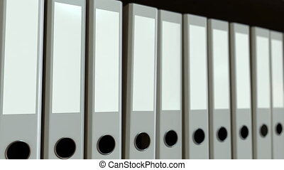 Row of grey office binders. Loopable motion background -...