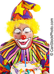 Clown Makes Birthday Wish - Clown makes a wish and blows out...