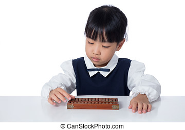 Asian Chinese little girl playing abacus in isolated white...