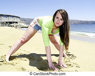 Girl stretching at beach