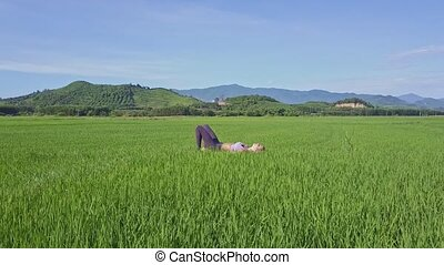 Young Woman Does Yoga against Distant Hills under Clear Sky