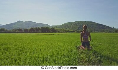 Blond Long Haired Girl Sits on Mat among Rice Field - blond...