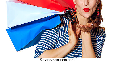 happy young woman shopper on white background blowing air...