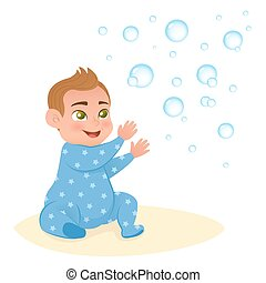 Cute little smiling baby boy playing with bubble