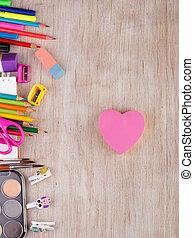 School supplies on wooden desk - Top view of school supplies...