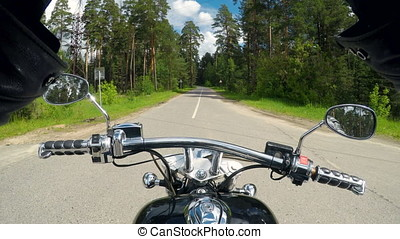 High speed motorcycle ride, handlebar close up. Forest...