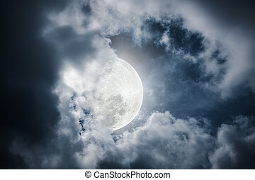 Nighttime sky with cloudy and bright moon would make a great...