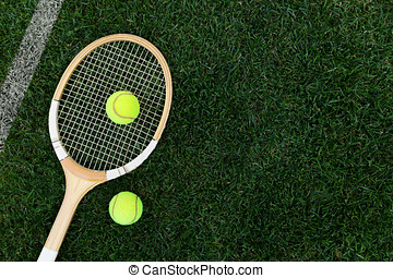 retro tennis racket on natural grass with balls. top view with copy space