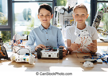 Lovely pre-teen boys posing with their robots - Our...