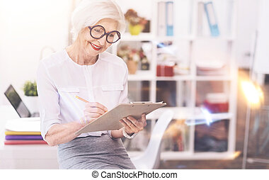 Active enterprising lady writing a schedule - Listing...