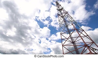 Telephone signal tower - Cell phone tower against a blue...