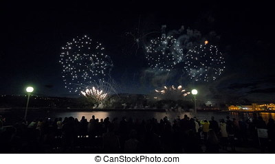 People are watching the firework. - People are watching the...