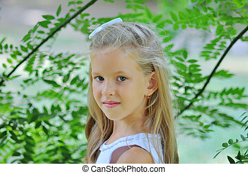 Cute little girl outdoors, in the park