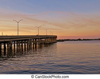 Sun setting at River walk along the Manatee River in...