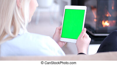 woman on sofa using tablet computer - young happy woman on...
