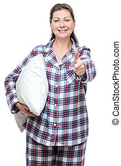 Satisfied young woman in pajama with pillow posing on white...