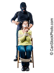 Terrorist in mask with arms and bound hostage on white background