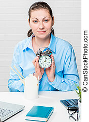 Vertical portrait of businesswoman at the table with an...