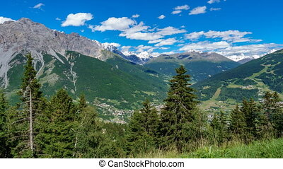Bormio city, valley and mountains time lapse - Top view of...