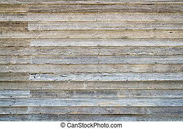 weathered wood siding of abandoned farm house - background...
