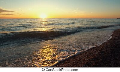 Sunset over the sea coast