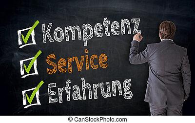 Businessman writes Kompetenz, Service, Erfahrung (in german...
