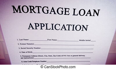 """Blank Mortgage loan application on a paper sheet."" -..."