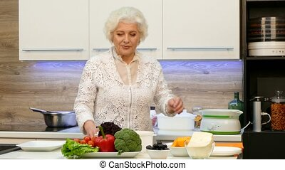Happy Granny Cooking In The Kitchen - Happy granny is...