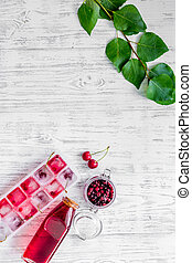 Cranberry morse with apple and pulm on wooden table...