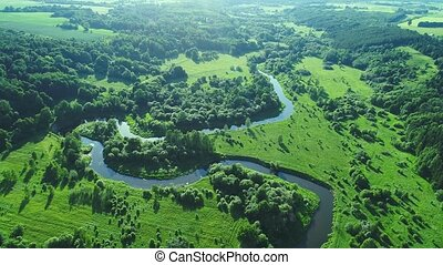 flight over river in meadows - flight over river in green...