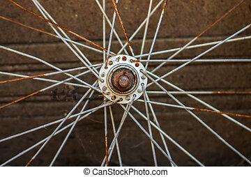 Rusted bike wheel symmetric