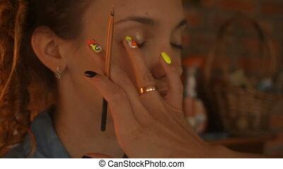 makeup artist paint brush eyes a woman - makeup artist paint...