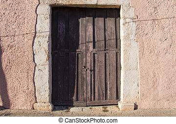 Old rustic colonial door and wall - Old wooden rustic door...